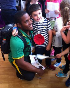 O'Dayne Richards with a youngster in Glasgow
