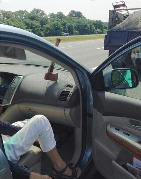 Photo shared by MSP of axe through windshield