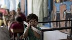 Palestinian child at the UN school in Gaza, 30 July