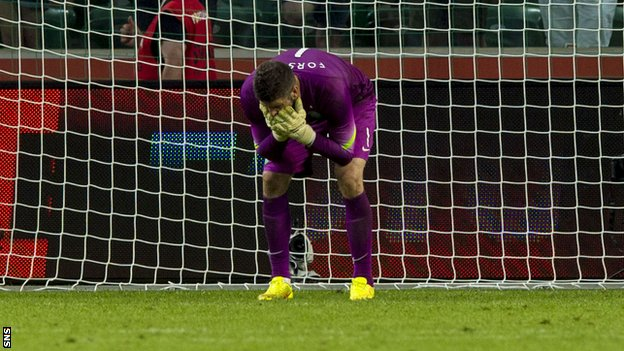 Celtic keeper Fraser Forster stands dejected as Leiga Warsaw score their fourth goal of the game.