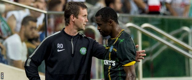 Ronny Deila consoles Efe Ambrose after his red card against Legia Warsaw.