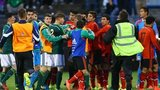 Northern Ireland and Mexico players fought during the Milk Cup game in Coleraine