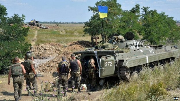 Ukrainian soldiers advancing through the countryside in Donetsk region - 30 July 2014