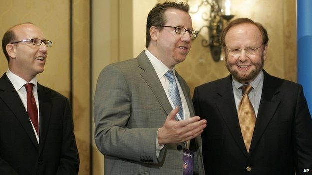 Joel Glazer, left, Bryan Glazer, center, and Tampa Bay Buccaneers team owner and president Malcolm Glazer