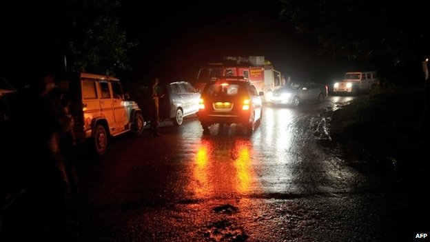 Emergency vehicles stalled at a barricade set up by police some 35km before the site of a landslide in Malin village in Pune district, India's western state of Maharashtra, on July 30, 2014