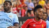 Liverpool's Raheem Sterling (right) gets in front of Micah Richards to score