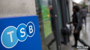 A woman walks into a branch of TSB bank