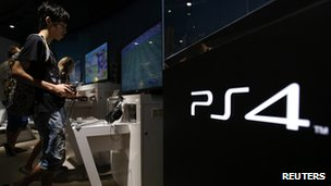 A man plays a video game on Sony's PlayStation 4 console