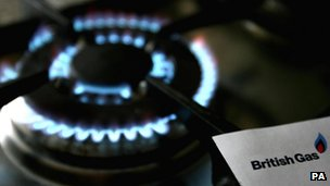 A gas hob flame with a British Gas bill