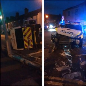 Crash in Burton involving a private ambulance and police car