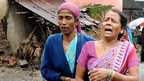 A villager consoles a neighbour who lost her relative in the landslide