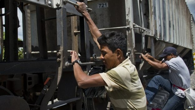 Central American migrants get on La Bestia cargo train in Apizaco on 22 July, 2014