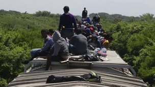 Unaccompanied minors ride atop the wagon of La Bestia (The Beast) in Ixtepec on 18 June, 2014.