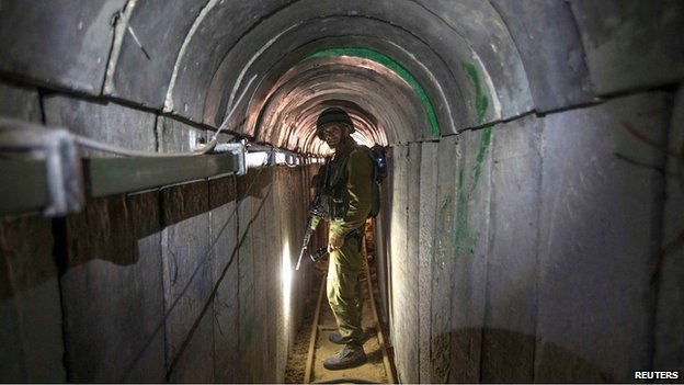 An Israeli soldier stands in a tunnel said to be captured from Hamas militants, 25 July 2014