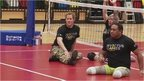 Prince Harry playing sitting volleyball