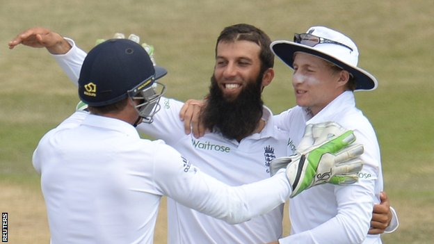 England's Moeen Ali is congratulated