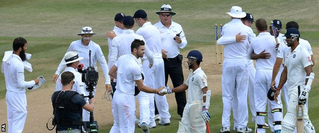 Players shake hands after England's win