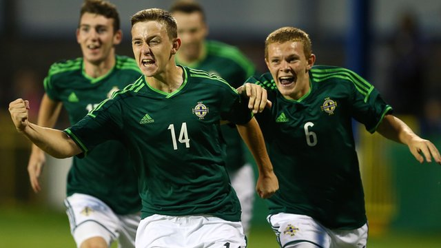 Mikhail Kennedy celebrates scoring against Mexico at the Milk Cup