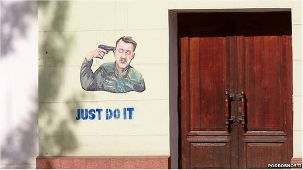 A caricature of pro-Russian separatist Igor Strelkov putting a gun to his head