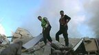 Men amongst rubble in Gaza