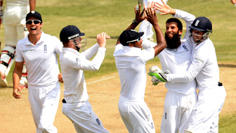 England celebrate a wicket against India