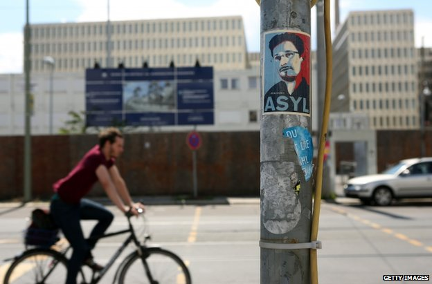 A poster near the partially finished new headquarters of Germany's Federal Intelligence Service in Berlin calling for asylum for Edward Snowden, 12 July