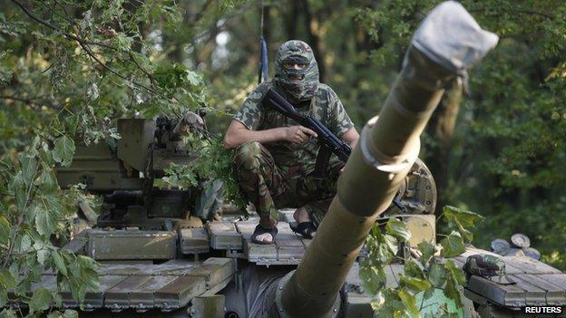 Pro-Russian rebel atop T-64 tank