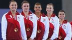 England's gymnastics women's team final winners wearing medals