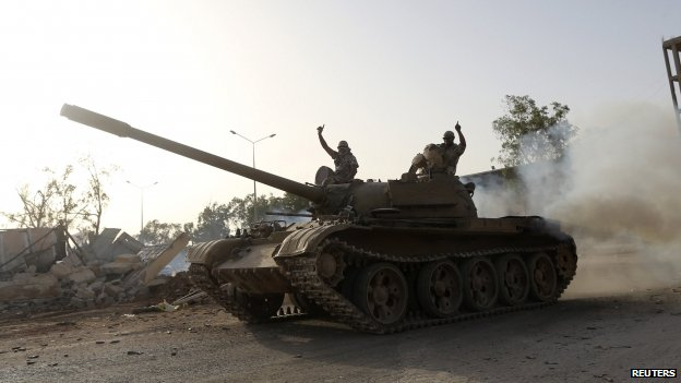 Fighters from the Benghazi Shura Council on top of a tank in Benghazi