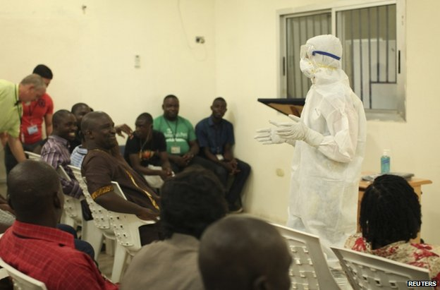 A Samaritan's Purse medical worker demonstrates personal protective equipment to educate team members on the Ebola virus in Liberia (undated photo)  </body></html>