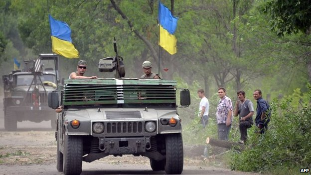 Ukrainian servicemen patrol in vehicles near eastern Ukraine