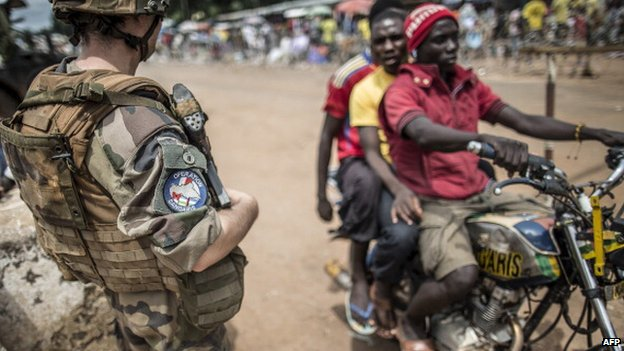 A French soldier mans a checkpoint in the formerly Muslim PK12 district of Bangui, CAR, on 4 June 2014