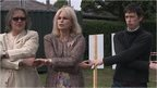 Joanna Lumley and Rory Stewart MP joining hands as part of a circle