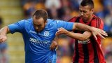 St Johnstone Lee croft (left) is challenged by Ivan Schranz