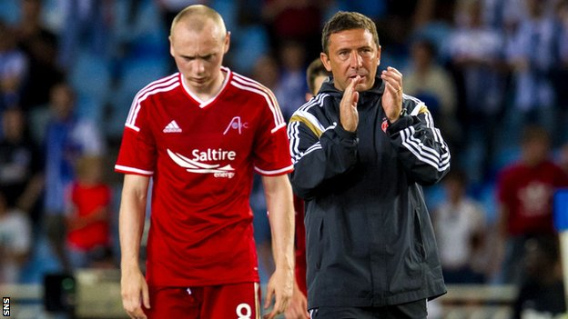 Derek McInnes (right) acknowledges the Aberdeen fans after defeat against Real Sociedad