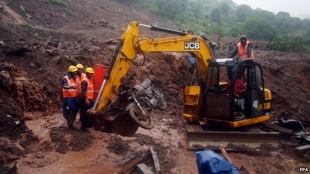 Indian rescue workers work at the site of a landslide in Malin village, Pune district, Maharashtra, India, 31 July 2014.
