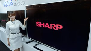 A model of Japan's electronics maker Sharp shows off new 4k liquid crystal display (LCD) TV
