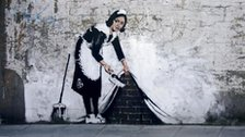 A graffiti artwork by Banksy