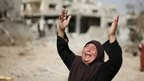 Palestinian woman reacts at sight of damaged house in Beit Hanoun - 1 August