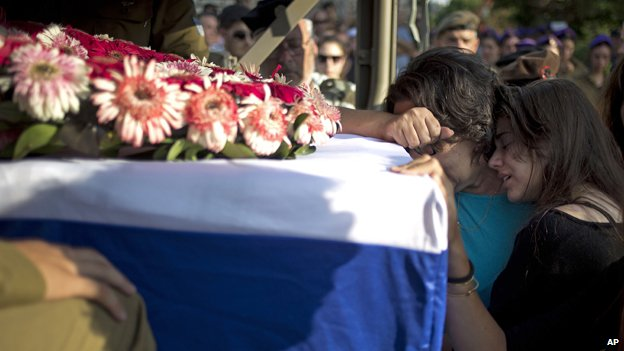 The mother and sister of Sgt Sagi Erez, 19, killed when Hamas fighters attacked from a tunnel, mourn his death