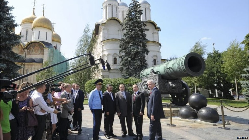 Russian President Vladimir Putin with Moscow Mayor Sergei Sobyanin (R) and other officials on the territory of the Kremlin in central Moscow.