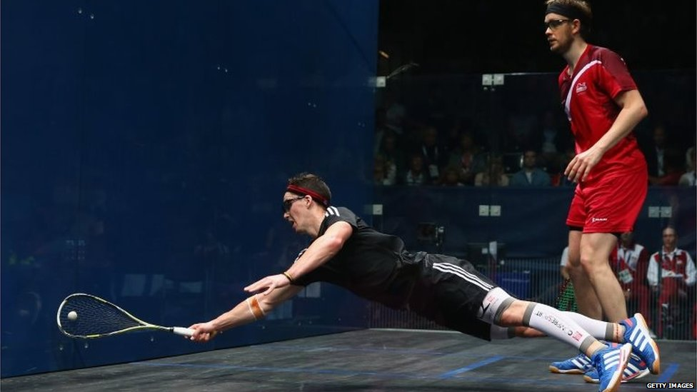 Paul Coll of New Zealand dives for the ball during the Men's doubles quarterfinals match against Daryl Selby and James Willstrop of England at Scotstoun Sports Campus during day nine of the Glasgow 2014 Commonwealth Games.