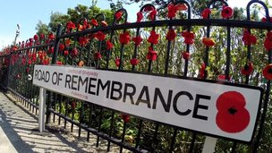 A sign reading 'Road of Remembrance'