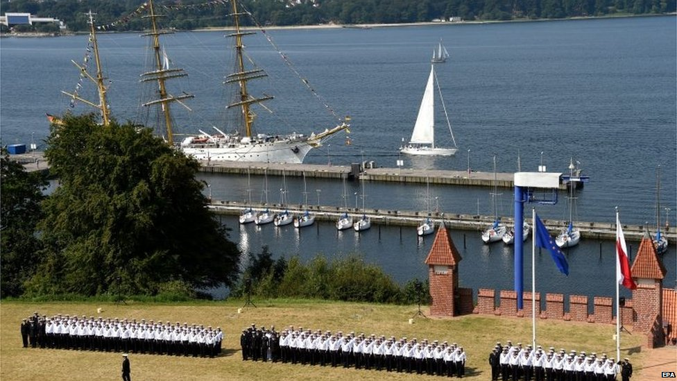German Navy soldiers stand to attention for their swearing-in in front of the Gorch Fock tall ship at the navy school Muerwik in Flensburg, Germany, 01 August 2014.