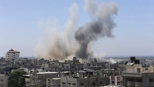 Smoke rising over buildings in Gaza