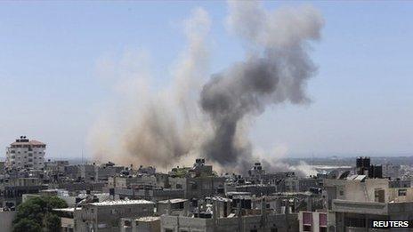Smoke rising over buildings in Gaza