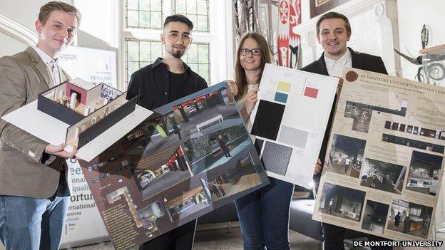 De Montfort University interior design students holding their ideas for the campus' heritage centre