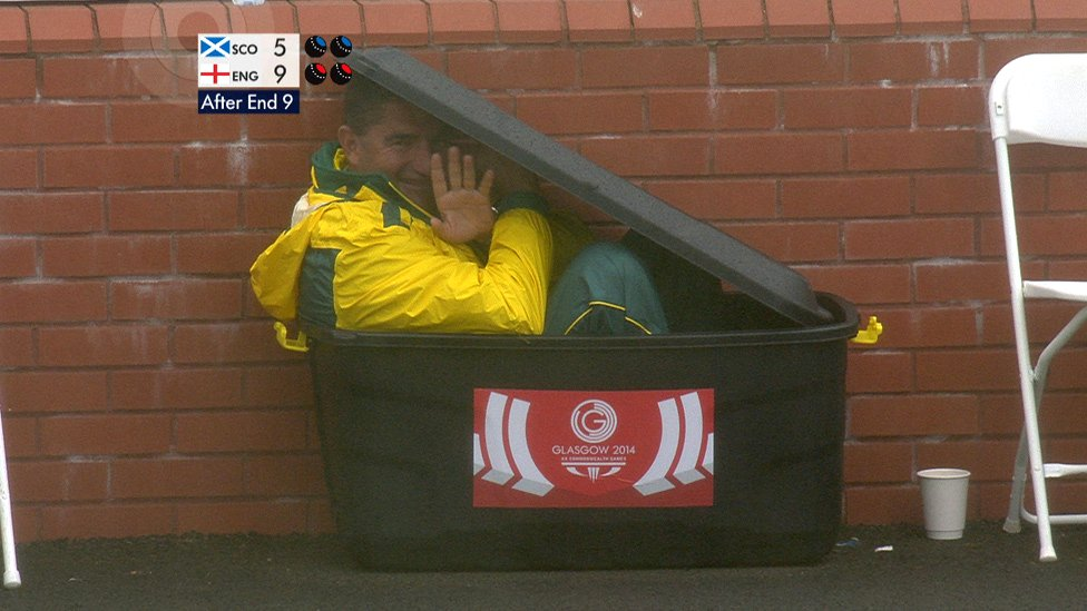 Kelvin Kerkow crouches in a crate