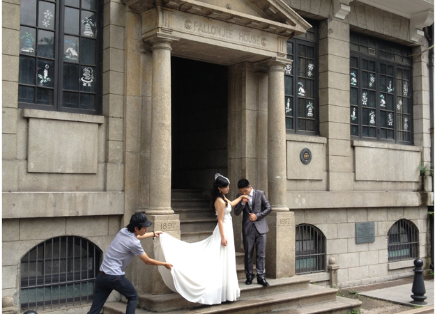 A couple who have just got married pose for photographs in Shamian Island
