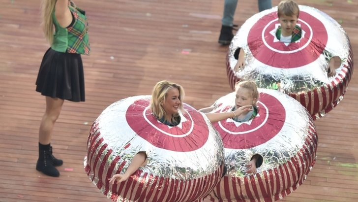 Performers dressed as Tunnocks chocolate teacakes, a renowned Scottish confectionary, perform during the opening ceremony of the 2014 Commonwealth Games at Celtic Park